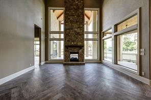 Gorgeous Flooring and Soaring Fireplace