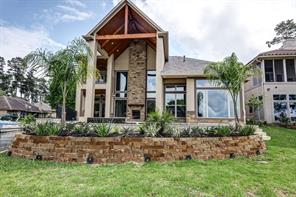 Tons of windows for those Expansive views of a park-like backyard and wide open views of lovely Lake Conroe! Canal is on side, open water to rear.