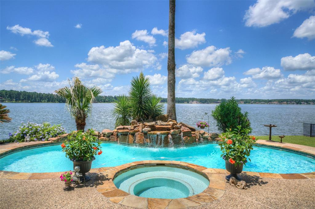 Live on a private island with dramatic open water views of Lake Conroe. An amazing 2-story entry with soaring arched windows and marble flooring will greet your guest's. An elegant spiral staircase will amaze you. A massive formal living and dining area with a wall of windows overlooking the pool and lake is sure to impress. An executive study with gorgeous built-ins is nearby. The island kitchen has tons of beautiful cabinetry, ample granite counter space and a huge pantry. The kitchen opens into the family room with a gorgeous gas log fireplace flanked by more built-ins, another wall of windows and breakfast nook. The master retreat has dual vanities, jetted tub with separate shower and a large walk-in closet. The spiral staircase leads up to the game room, balcony, 3 more bedrooms, 2 baths and a bonus room. Lake views from nearly every room in this amazing home. Over-sized 3 car garage, new roof in 2017. An exceptional and well kept home with special one-of-kind features throughout.