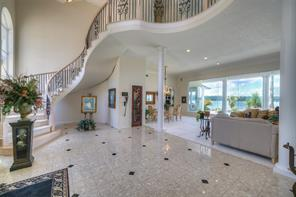 The soaring 2 story entry with the amazing winding stairway.