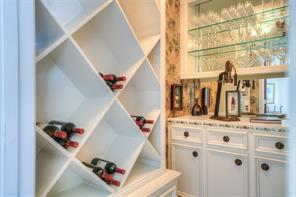 Another view of the wine room with pretty built-in cabinetry.