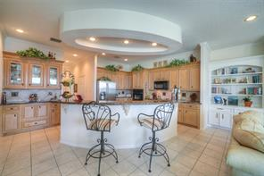 The kitchen is a chef's dream with large island and breakfast bar.
