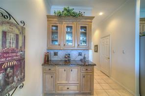 The built in buffet allows for even more storage. The large walk-in pantry is inside the door to the Right.