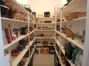 Storage galore in this gigantic walk-in pantry.