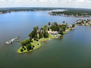 Live on a private island with your very own park and panoramic views of Lake Conroe.