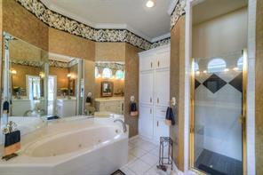 The Master Bathroom has a jetted tub and a walk-in shower.