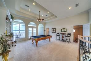 Upon reaching the 2nd level you will be greeted by a beautiful game room with French Doors opening to a large balcony