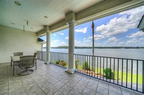 The large balcony off of the game room allows for panoramic views of Lake Conroe.