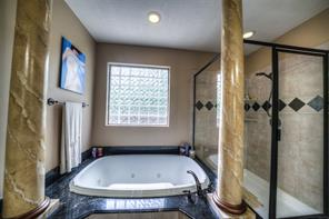 Jetted tub is large. Note the oil-rubbed bronze fixtures.