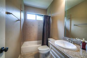 Full guest bath up has tile and natural light.