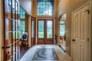Beautiful leaded glass door entry with stylish mosaic and don't miss the dome ceiling. Study and dining room are off the front entry.