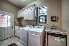 Very nice utility room with sink and small fridge for pool refreshments.