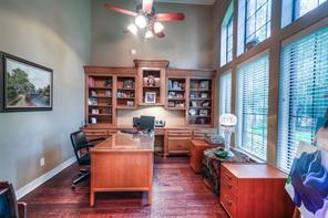 Built-ins and wood flooring compliment the study with big windows for natural light.
