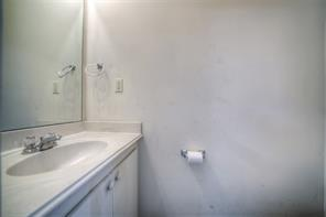 Convenient half bath is located in garage for swimmers or those who are covered in dirt.