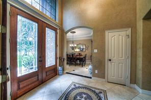 Formal dining is to through the left arched doorway, has tray ceiling and crown molding. Note the cot closet near the front door.