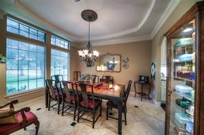 Very spacious formal dining room has butler's pantry through to the kitchen and plenty of space for a large table and cabinet.