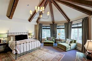 Unparalleled master suite features stunning vaulted ceiling with antique beams!  Fireplace, wall of windows, and iron chandelier complete the space!  Simply beautiful!