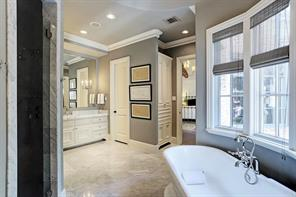 View of the second sink area and private water closet.  This master bathroom even has a coffee bar with sink and refrigerator.  PLUS,  two separate master closets!