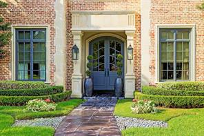 Outstanding curb appeal does not disappoint!  Well manicured yard, gas lantern lighting, and double arched front doors welcome your guests.