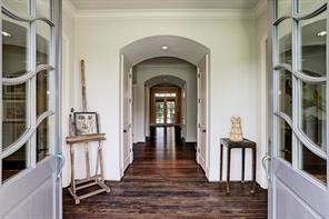 Many architectural elements enhance this Tanglewood home and are revealed as soon as you open the door!