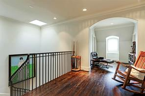 3rd floor landing with sitting area, floored attic space, the 6th bedroom, and exercise room.