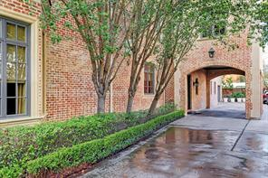 Gated driveway has 1 car Porte-Cochere!  Plenty of additional parking available as well as a 3 car garage!