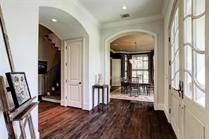 The entry is planked with the dining room and the handsome study.  Front stair case is just beyond the entry.