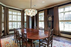 Elegant formal dining room with loads of natural light, leather wall coverings, and custom ceiling coverings!  The room has deep moldings, hardwood floors, recessed and designer lighting! Plenty of room for large gatherings!