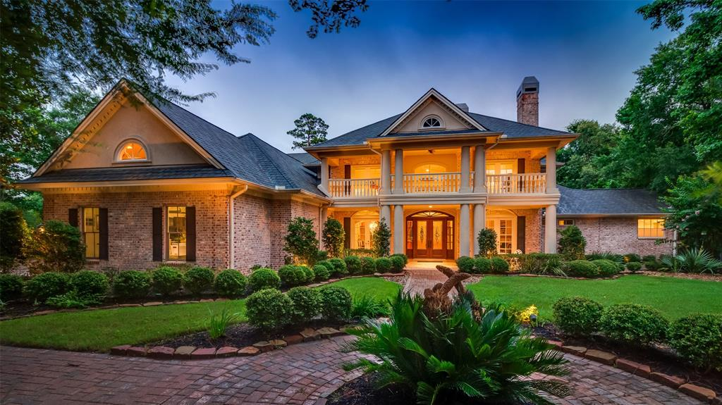 An exquisite Georgian style residence in Carlton Woods, reminiscent of gracious southern estates of the past.  Sitting on over one acre of lushly landscaped grounds, this grand home overlooks the Signature Hole # 15 of the Jack Nicklaus course and the pond . The entrance with travertine flooring, opens to formal dining and living rooms. Downstairs also includes a custom study with built-ins and cozy fireplace, tranquil master suite, authentic wine cellar and a gorgeous chef's kitchen with Thermador appliances and natural granite countertops, including a large breakfast bar and opens to the expansive family room and breakfast room, all looking over the course., A lovely guest room with ensuite bath is also downstairs.  There are two staircases leading upstairs with  two large game rooms, media room, craft room, three additional bedrooms, plus two full and one half baths. Balconies and patios, a fantastic pergola with tv, fireplace and summer kitchen a great living environment.