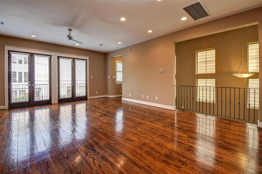 Gleaming Hardwood Floors And Abundant Natural Light Fill The Living Room.