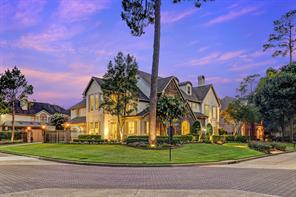 The home is situated on the corner of the two major boulevards in Stablewood - Stable Crest and Stablewood boulevards.  The 14,698 +/- square foot lot is beautifully landscaped with finely manicured gardens and side driveway with wrought iron gate leading to the three car garage.