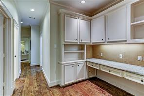 One of four GUEST BEDROOMS - this one (15 X 12) with carpeted flooring, shuttered windows, painted walls, ceiling fan, recessed lighting, crown/base molding, walk-in closet and en suite bath.