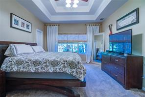 MASTER BEDROOM HAS TREY CEILING AND A LARGE THREE PANEL WINDOW FOR NATURE LIGHT.