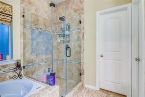 STAND ALONE SHOWER WITH TITLE IN MASTER BATH.