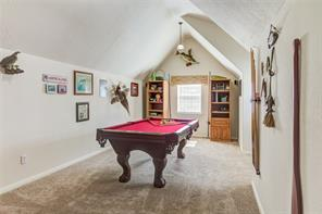 PLAYROOM UPSTAIRS. POOL TABLE REMAINS WITH THE HOME.