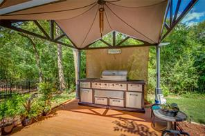 THIS OUTDOOR KITCHEN AND COVERING WILL REMAIN WITH THE HOME.