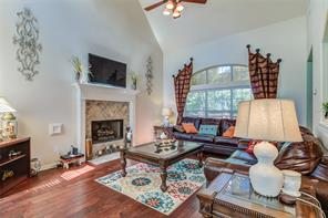 LIVINGROOM FEATURES INCLUDE VAULTED CEILING, GAS LOG FIREPLACE, DRAPE DRESSING, ARCHED WINDOW AND NATURE LIGHTING.