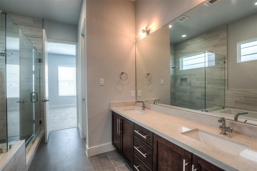 Modern master bath with dual vanities.