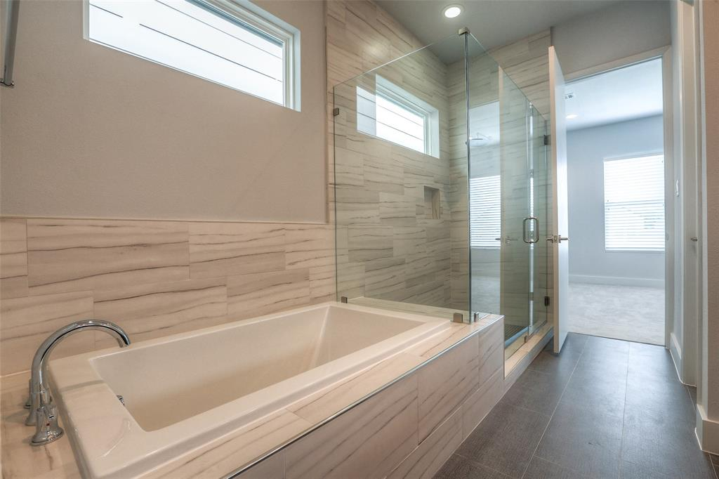 Master bath features a separate tub and shower