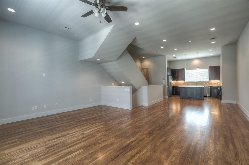 The open floor plans features wood floors and lots of natural light.