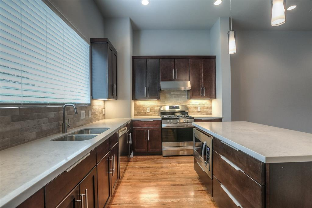 The family chef will love the center island kitchen with gas range.