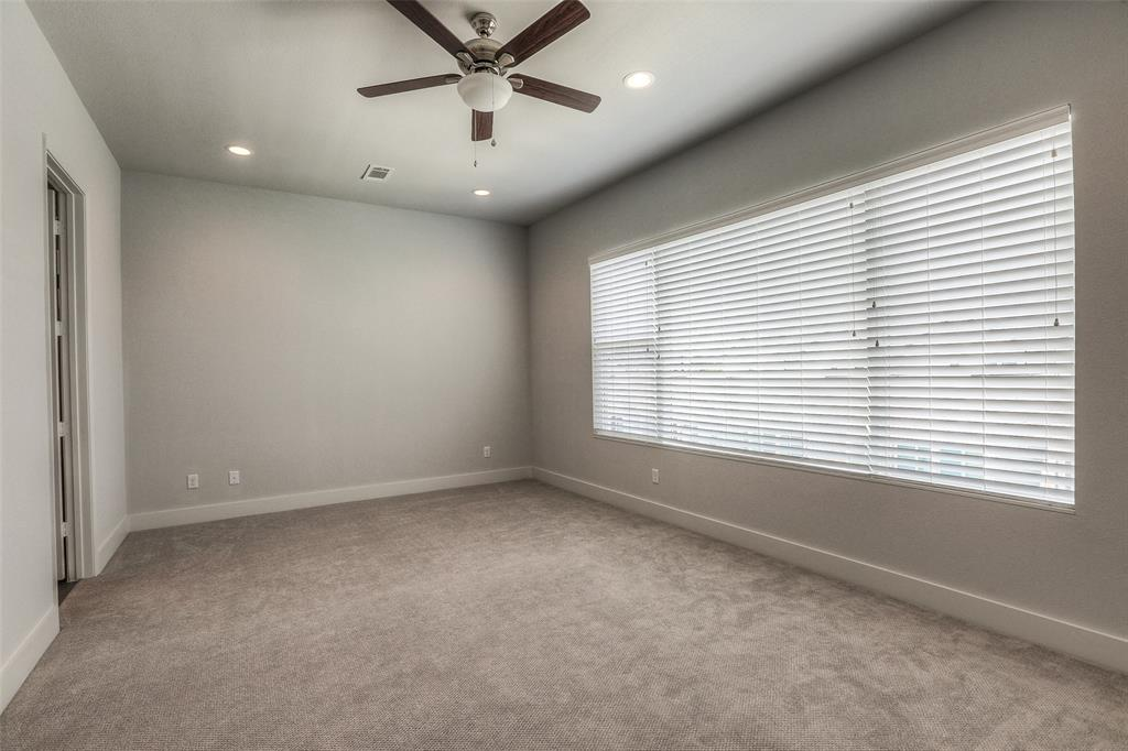 Large master bedroom with excellent closet space and recessed lights.