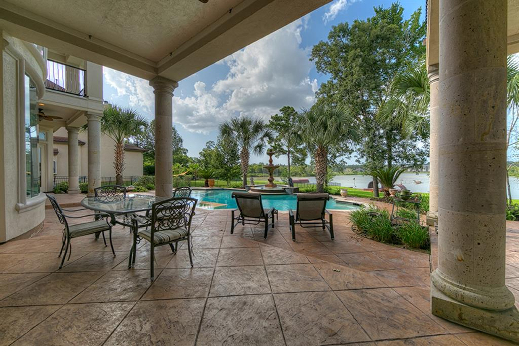 Stunning Mediterranean style waterfront home in the gated community of Harbor Side. This 5296 SF home offers 5 bedroom, 4 full baths, 1 half bath and a cabana bath off the patio pool side. The 2 acre estate is designed for entertaining with a gourmet kitchen, wet bar and large living areas. There is a secondary bedroom downstairs with a full bath in addition to the Master Suite. The study is outfitted with beautiful hardwood builtins overlooking the pool and lake. The back patio is build to enjoy the sprawling backyard and lake while cooling off in the beautifully finished pool with LED lighting, fountains and hot tub. The patio is fully equipped to easily put in your idea of an outdoor kitchen with plumbing and gas already in place. The full 2 acres is watered from Lake Conroe a there is freshwater plumbed from the house to the boat dock. The home has custom features found throughout and is truly a must see!