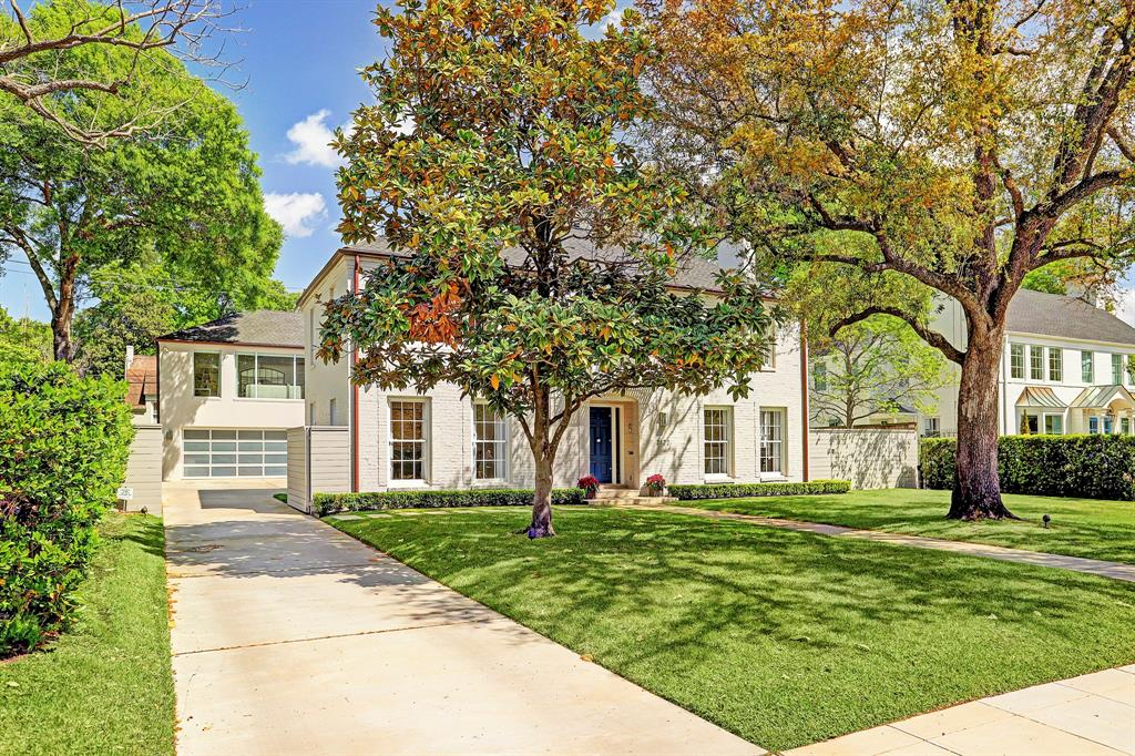 Pristine grounds mark the simplicity of this picture-perfect residence where majestic trees serve as the perfect introduction to a real gem that quietly resonates with the modern purist.