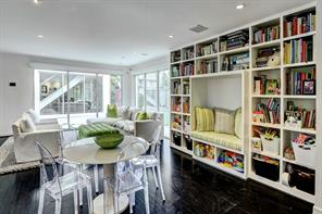 Nestled in an enviable position, the extension of the family room comprises fantastic options for display of books, games and toys while incorporating a built-in seating area.