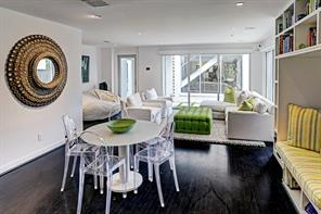 Gleaming hardwood floors anchor the family room where an over- abundance of glass provides a refreshing light-filled mood for every day living.