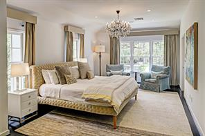 Elegance is the hallmark of the beautiful sun-lit master bedroom.  A trio of sparkling windows yields welcome treetop views.  Features include recessed lighting, hardwood floors and drapery pockets.