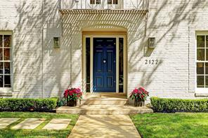 Unmistakable in beauty, the commanding front door and delightful balcony distinguish the front entrance.