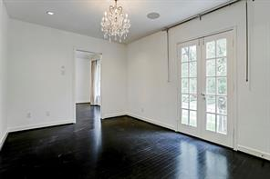 Off the Master is a wonderful room with Juliet balcony doors facing south to the magnificent front yard. This could be an office, study, gym or another walk in master closet! Abundant light and ceiling speakers  with chandelier add to the charm of this multi purpose room!