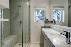 Every bedroom is ensuite with like new bathrooms! Quartz countertops and solid glass backsplash shower with seat and lots of light in this white secondary bathroom on the second floor.